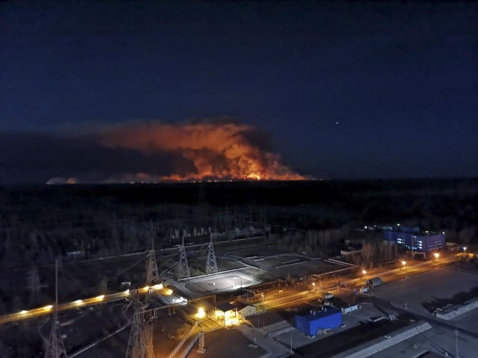 In this photo taken from the roof of Ukraine's Chernobyl nuclear power plant late Friday April 10, 2020, a forest fire is seen burning near the plant inside the exclusion zone.  Ukrainian firefighters are labouring to put out two forest blazes in the area around the Chernobyl nuclear power station that was evacuated because of radioactive contamination after the 1986 explosion at the plant. (Ukrainian Police Press Office via AP)