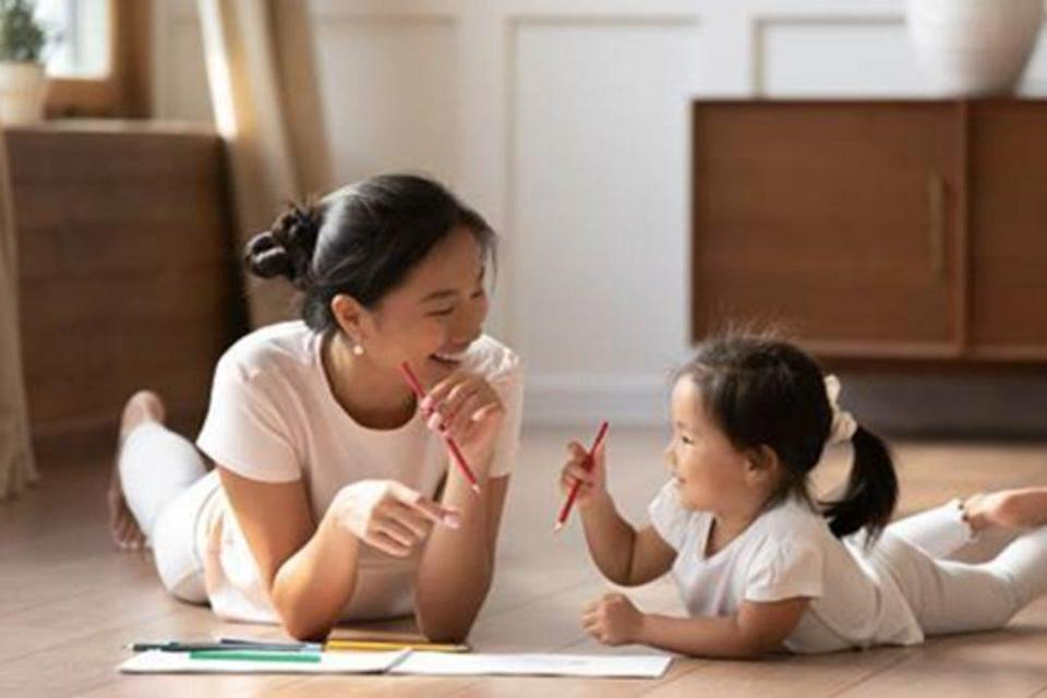 Child reading with mother  (Tonies )