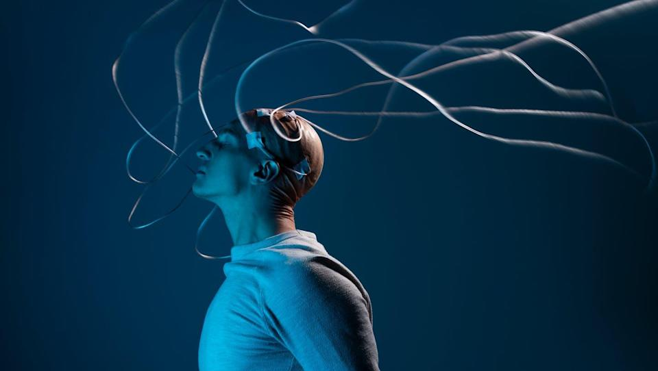 An illustration of a man with wires coming out of his head