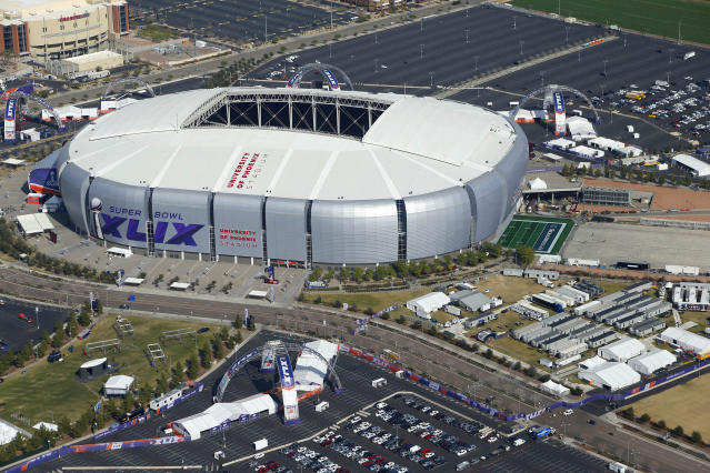FILE - This is a Jan. 28, 2015, aerial file photo showing University of Phoenix Stadium in Glendale, Ariz., site of Super Bowl XLIX. The NFL has awarded future Super Bowls to Arizona and New Orleans. The decision was made Wednesday, May 23, 2018, at the league's annual spring meeting in Atlanta, which will host the 2019 Super Bowl at Mercedes-Benz Stadium. (AP Photo/Ross D. Franklin, FIle)