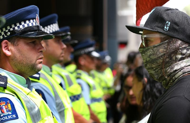 Demonstrators and police come face to face as they close down streets in Auckland to protest against the Trans-Pacific Partnership agreement on February 3, 2016 (AFP Photo/Michael Bradley)