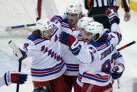 New York Rangers' Mika Zibanejad, rights celebrates his goal with teammates during the third period of the NHL hockey game against the New Jersey Devils in Newark, N.J., Sunday, April 18, 2021. (AP Photo/Seth Wenig)