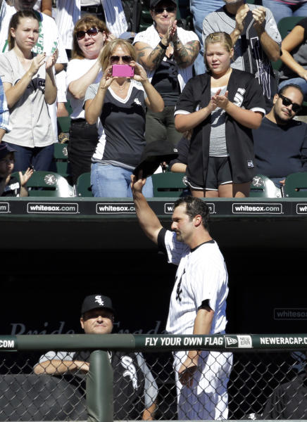 Chicago White Sox's Paul Konerko waves to fans after Conor Gillaspie replaced him during the second inning of a baseball game against the Kansas City Royals in Chicago, Sunday, Sept. 29, 2013. (AP Photo/Nam Y. Huh)