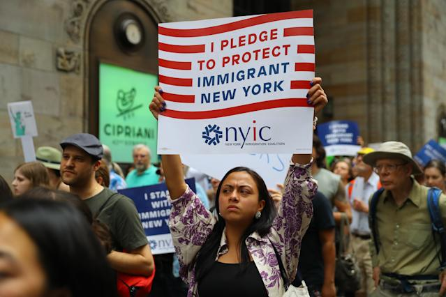 <p>Beatrice of Manhattan holds up a sign in pledging her support for immigration rights at a protest against U.S. immigration policies in New York City on June 20, 2018. (Photo: Gordon Donovan/Yahoo News) </p>
