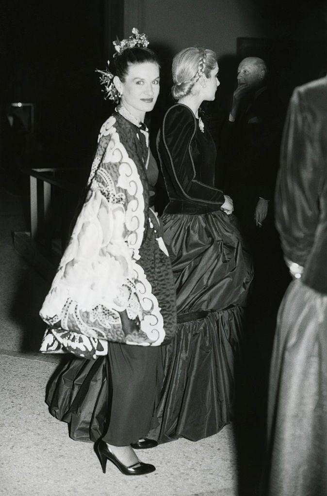 <p>Paloma Picasso wears an elaborate design to the Metropolitan Museum's Costume Institute Gala, which she arrives at with fellow fashion designer, Carolina Herrera. The Spanish-French designer is the daughter of renowned painter, Pablo Picasso. </p>