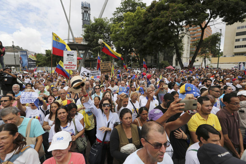 Opponents of Nicolas Maduro's government attend a rally led by opposition leader Juan Guaidó, in Caracas, Venezuela, Saturday, May 11, 2019. Guaidó has called for nationwide marches protesting the Maduro government, demanding new elections and the release of jailed opposition lawmakers. (AP Photo/Fernando Llano)