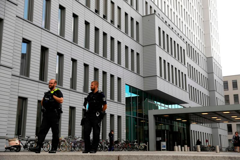 German police officers stand guard outside Berlin's Charite hospital where Alexei Navalny is treated after his medical evacuation to Germany (AFP via Getty Images)