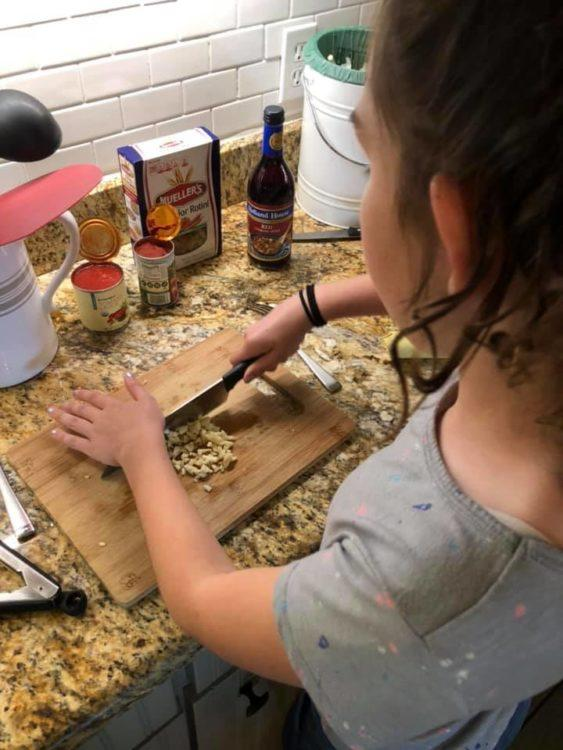 little girl learning to cook