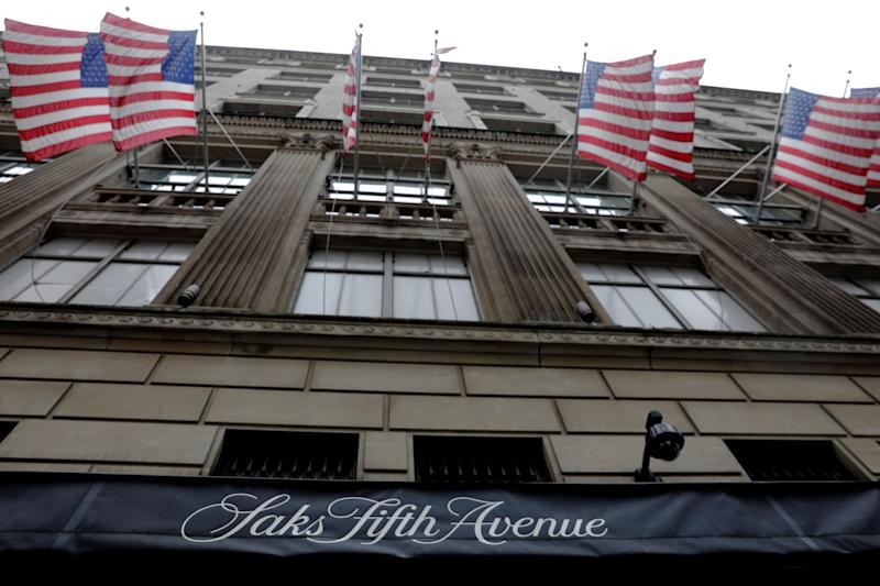 U.S. flags fly outside of Saks Fifth Avenue in New York, U.S., June 19, 2017. REUTERS/Lucas Jackson