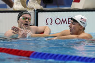 Lewis Clareburt, left, of New Zealand and Chase Kalisz, of the United States, shake hands following their heat in the men's 400-meter individual medleyat the 2020 Summer Olympics, Saturday, July 24, 2021, in Tokyo, Japan. (AP Photo/Martin Meissner)