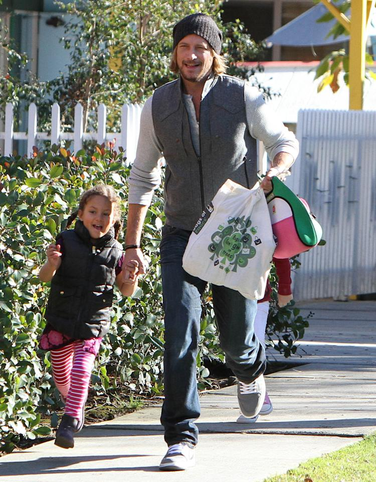 January 16, 2013: Gabriel Aubry spotted skipping down the sidewalk with daughter Nahla after picking her up from school in Los Angeles, CA.