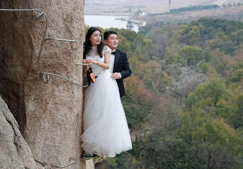 This couple decided to scale a cliff for their wedding photos. Photo: Australscope