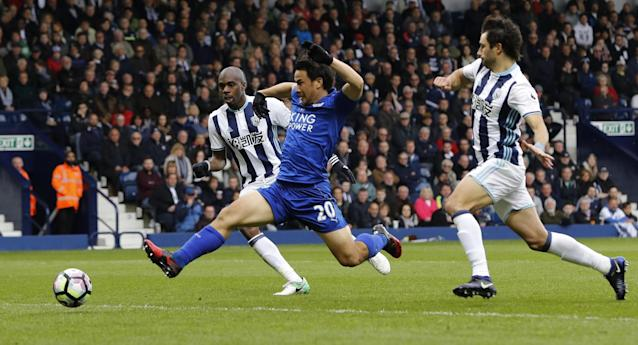 <p>Leicester City's Shinji Okazaki in action with West Bromwich Albion's Allan Nyom and Claudio Yacob </p>