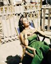 <p>The actress is seen relaxing as she lays out for a sun tan during a break on set. </p>