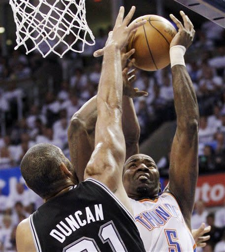 Oklahoma City Thunder center Kendrick Perkins (5) is defended by San Antonio Spurs center Tim Duncan (21) during the first half of Game 6 in the NBA basketball Western Conference finals, Wednesday, June 6, 2012, in Oklahoma City. (AP Photo/Sue Ogrocki)