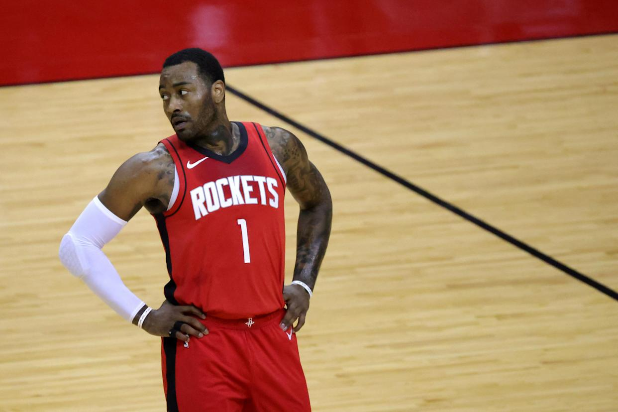 Feb 22, 2021; Houston, Texas, USA; John Wall #1 of the Houston Rockets looks on during the first quarter against the Chicago Bulls at Toyota Center. Mandatory Credit: Carmen Mandato/Pool Photo-USA TODAY Sports