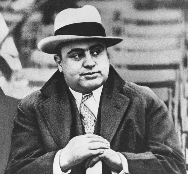 FILE - In this Jan. 19, 1931 file photo, Chicago mobster Al Capone attends a football game in Chicago. On Thursday, Feb. 14, 2013, the Chicago Crime Commission and the Drug Enforcement Administration are scheduled to name Joaquin Guzman Loera, a cartel kingpin in Mexico, as the new Public Enemy No. 1. It will the first time since Prohibition-era gangster Capone that authorities in the city deemed a crime figure so ominous a threat to deserve the label. (AP Photo/File)