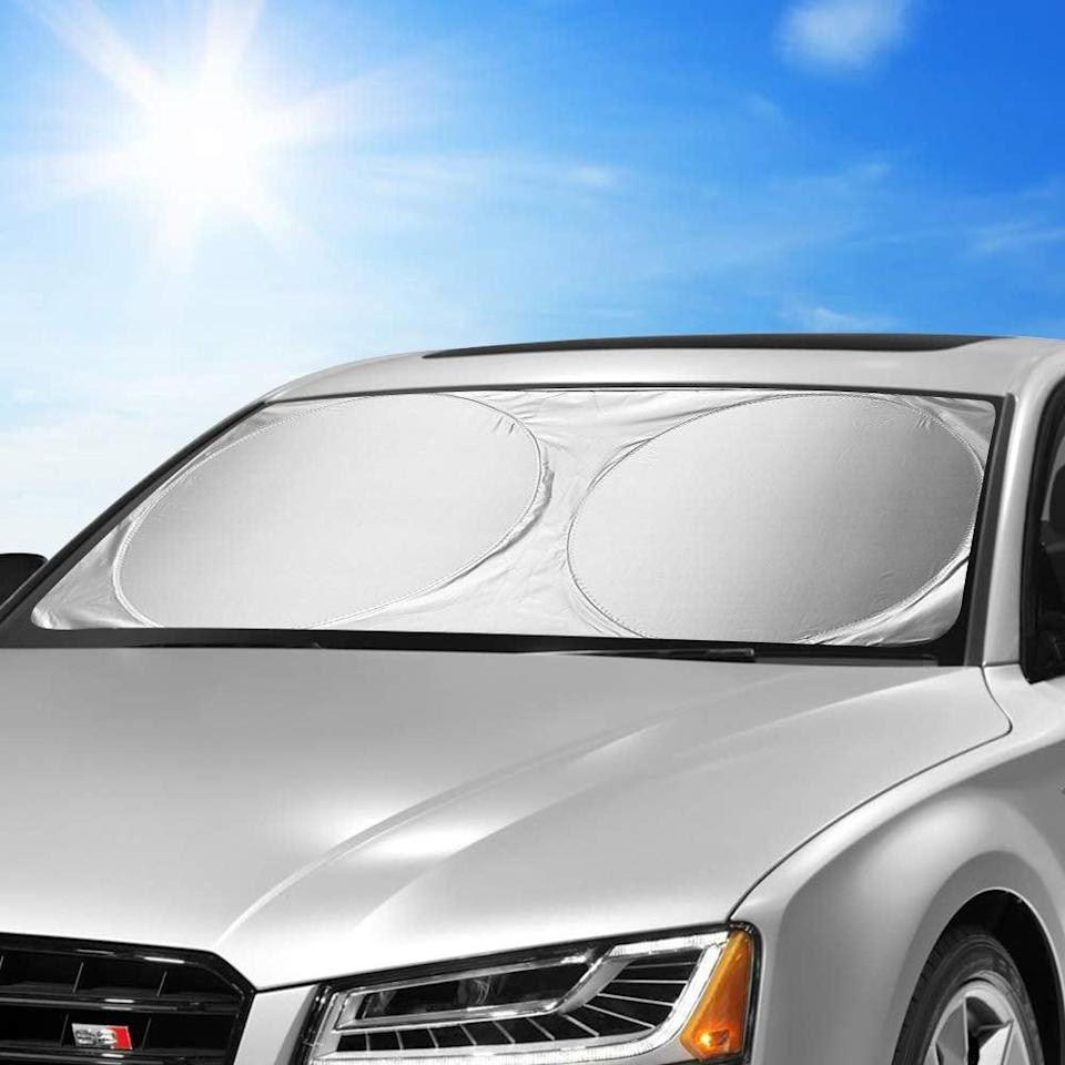 <p>Keep your car from heating up in the first place with this <span>Foldable Windshield Sun Shade</span> ($14).</p>