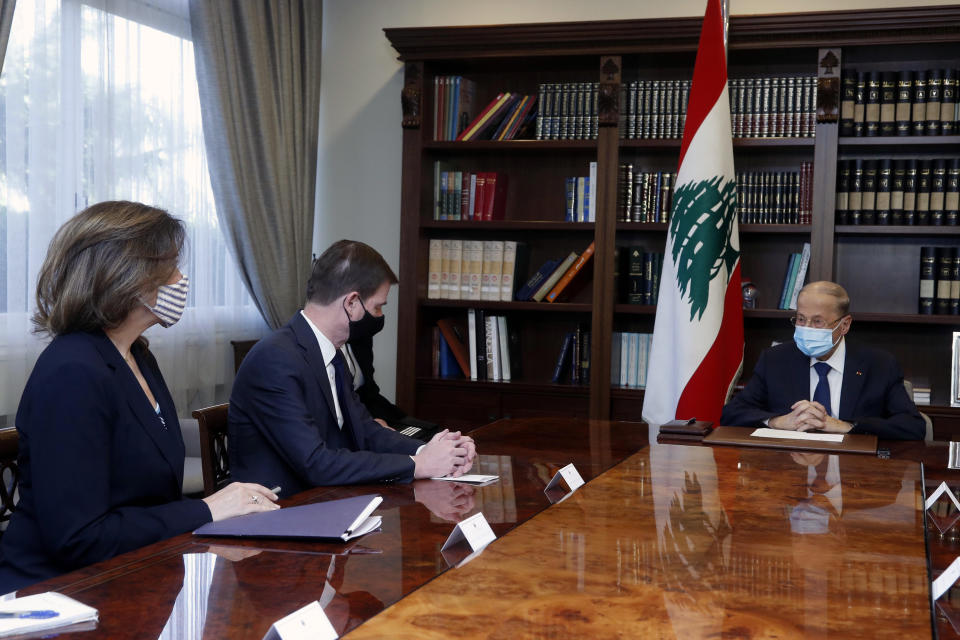 In this photo released by the Lebanese government, Lebanese President Michel Aoun, right, meets with U.S. Undersecretary of State for Political Affairs David Hale, center, and, U.S. Ambassador to Lebanon Dorothy Shea, left, at the presidential palace, in Baabda, east of Beirut, Lebanon, Thursday, April 15, 2021. (Dalati Nohra/Lebanese Official Government via AP)