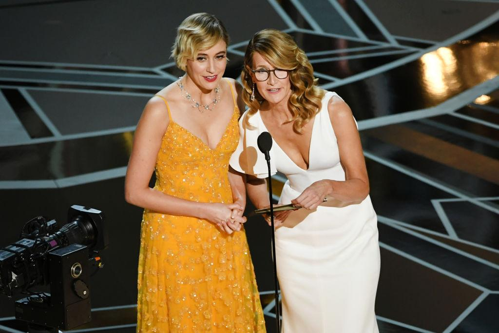 <p>Laura Dern wears tortoise frames with her white Calvin Klein by Appointment dress while presenting alongside Greta Gerwig at the 2018 Oscars. (Photo: Getty Images) </p>