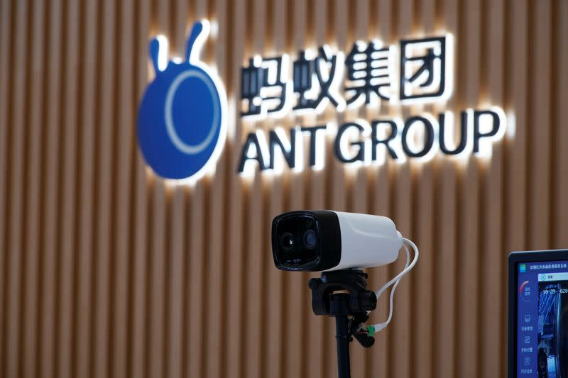 A thermal imaging camera is seen in front of a logo of Ant Group at the headquarters of Ant Group, an affiliate of Alibaba, in Hangzhou