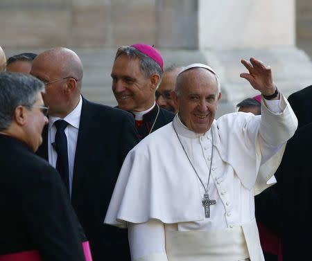 Pope Francis waves as he arrives at the Duomo, the Cathedral of Milan, in Milan