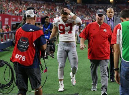 FILE PHOTO: Sep 15, 2018; Arlington, TX, USA; Ohio State Buckeyes defensive end Nick Bosa (97) walks to the locker room injured in the third quarter against the Texas Christian Horned Frogs at AT&T Stadium. Mandatory Credit: Matthew Emmons-USA TODAY Sports