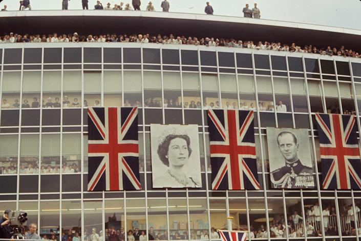 """Crowds peer out windows and balconies to catch a glimpse of Queen Elizabeth II and Prince Philip, Bonn, Germany, May 1965.<span class=""""copyright"""">Paul Schutzer—The LIFE Picture Collection/Getty Images</span>"""