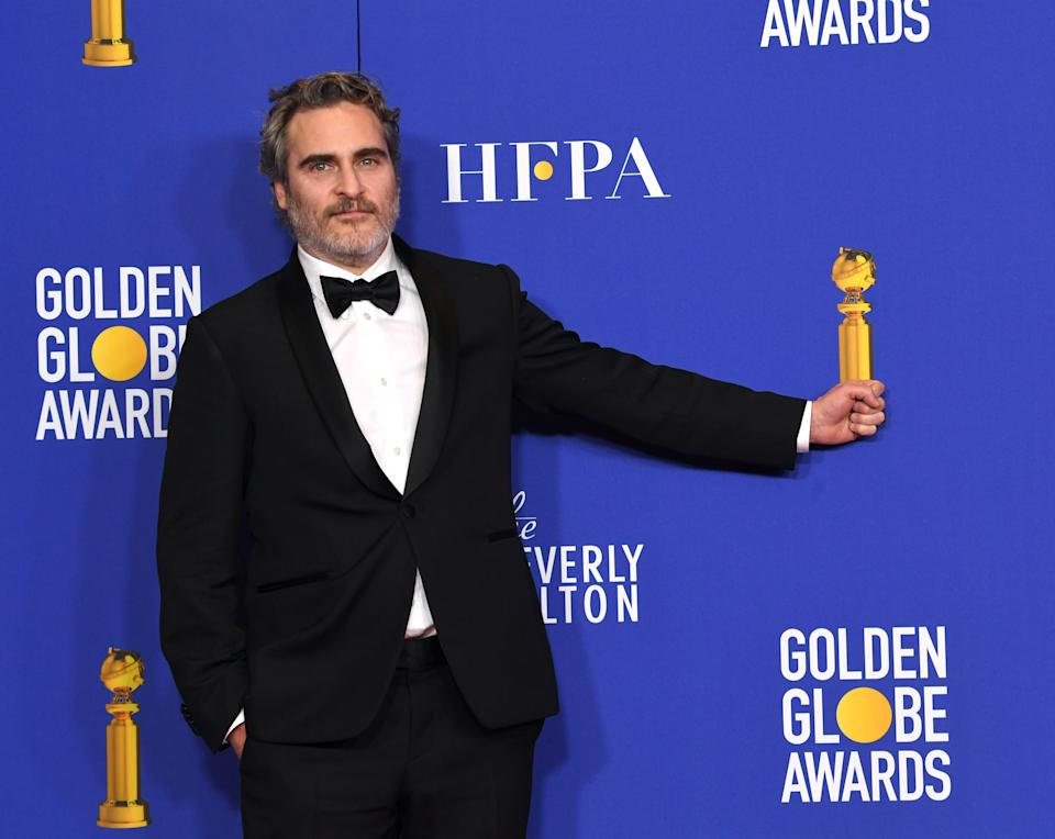 """Joaquin Phoenix , winner of Best Performance by an Actor in a Motion Picture - Drama  for """"Joker"""" poses in the press room during the 77th Annual Golden Globe Awards at The Beverly Hilton Hotel on January 05, 2020 in Beverly Hills, California. (Photo by Kevin Winter/Getty Images)"""