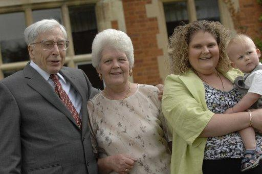 Louise Brown (2nd R) posing with her son Cameron (R), her mother Lesley Brown (2nd L) and IVF pioneer Robert Edwards