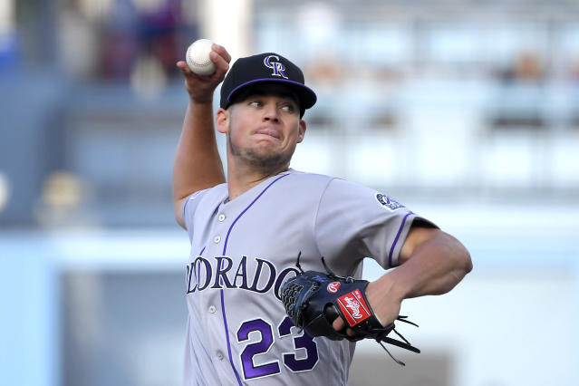 Colorado Rockies' Peter Lambert throws to the plate during the first inning of a baseball against the Los Angeles Dodgers game Monday, Sept. 2, 2019, in Los Angeles. (AP Photo/Mark J. Terrill)