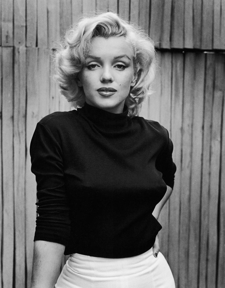 """Marilyn Monroe is perhaps the most famous example of a celebrity who changed their birth name. Born Norma Jeane Mortenson, the actor later used her mother's last name, Baker, until she married her first husband, James Dougherty. But when she signed a contract with 20th Century Fox, studio executive Ben Lyon thought there were too many possible pronunciations of """"Dougherty."""" They finally settled on Marilyn Monroe. It seems the late actor was pleased with the change because she <a href=""""https://time.com/5368339/marilyn-monroe-real-name-story/"""" rel=""""nofollow noopener"""" target=""""_blank"""" data-ylk=""""slk:inscribed a photograph to him"""" class=""""link rapid-noclick-resp"""">inscribed a photograph to him</a> with, """"Dear Ben, You found me, named me, and believed in me when no one else did. My thanks and love forever. Marilyn."""""""