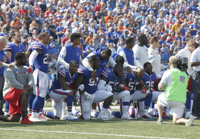 <p>Buffalo Bills players kneel in protest during the National Anthem before a game against the Denver Broncos at New Era Field. Mandatory Credit: Timothy T. Ludwig-USA TODAY Sports </p>
