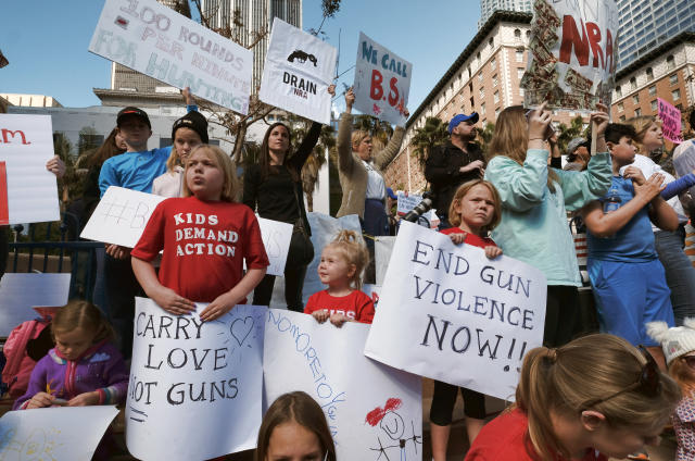 <p>Children join their parents during a protest rally against gun violence in downtown Los Angeles on Monday, Feb. 19, 2018. (Photo: Richard Vogel/AP) </p>