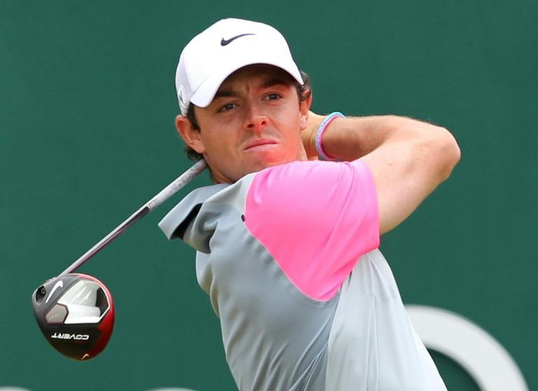 Northern Ireland's Rory McIlroy watches his shot from the 1st tee during his fourth round, on the final day of the British Open at Royal Liverpool Golf Course in Hoylake, northwest England, on July 20, 2014 (AFP Photo/Peter Muhly)