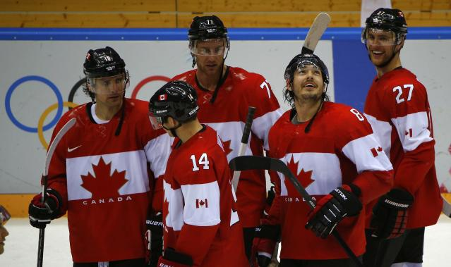 Canada's Drew Doughty (8) reacts with teammates Patrick Sharp (10), Jeff Carter (77), Chris Kunitz (14) and Alex Pietrangelo (27) after his game winning overtime goal against Finland during their men's preliminary round ice hockey game at the Sochi 2014 Winter Olympic Games February 16, 2014. REUTERS/Brian Snyder (RUSSIA - Tags: SPORT ICE HOCKEY OLYMPICS)