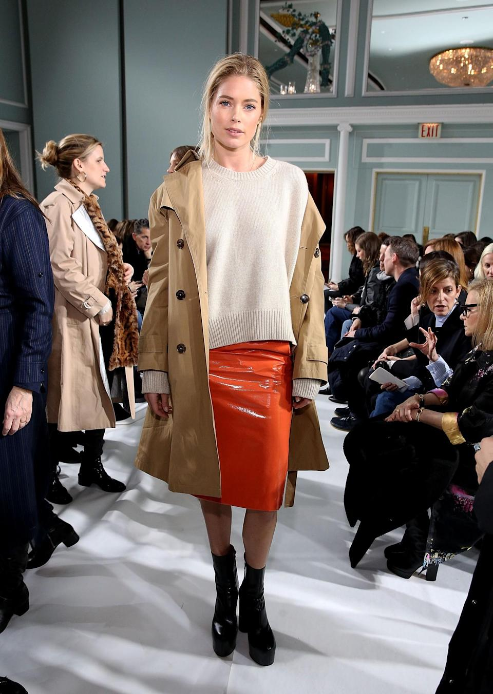<p>Doutzen Kroes was dressed in an orange vinyl skirt and trench coat. <i>[Photo: Getty]</i> </p>