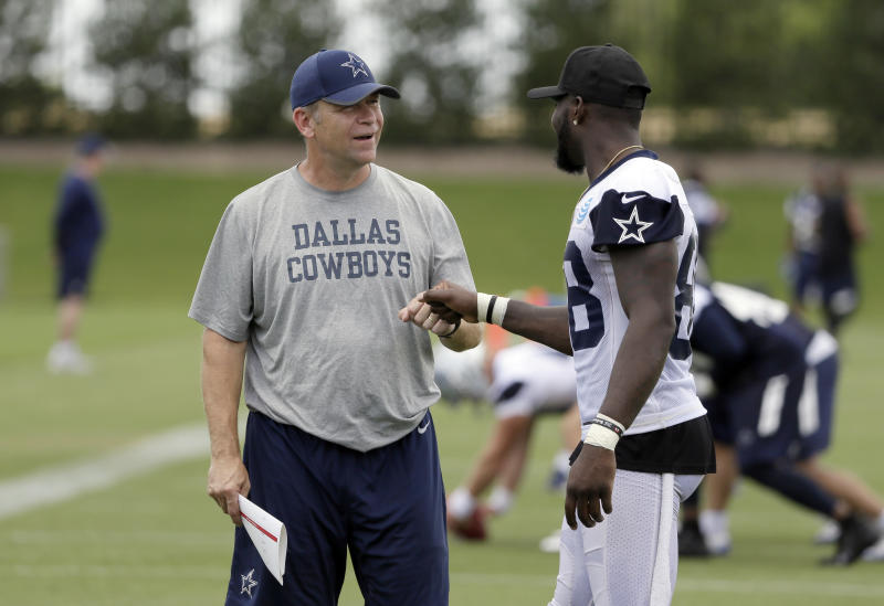The play-calling of offensive coordinator Scott Linehan (L) faced heavy scrutiny this season. (AP)