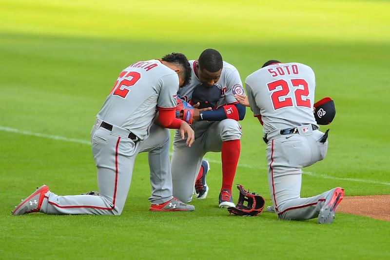 ATLANTA, GA AUGUST 17: Washington Nationals shortstop Luis Garcia (62), center fielder Victor Robles (16), and left fielder Juan Soto (22) say a prayer prior the start of the MLB game between the Washington Nationals and the Atlanta Braves on August 17th, 2020 at Truist Park in Atlanta, GA. (Photo by Rich von Biberstein/Icon Sportswire via Getty Images)