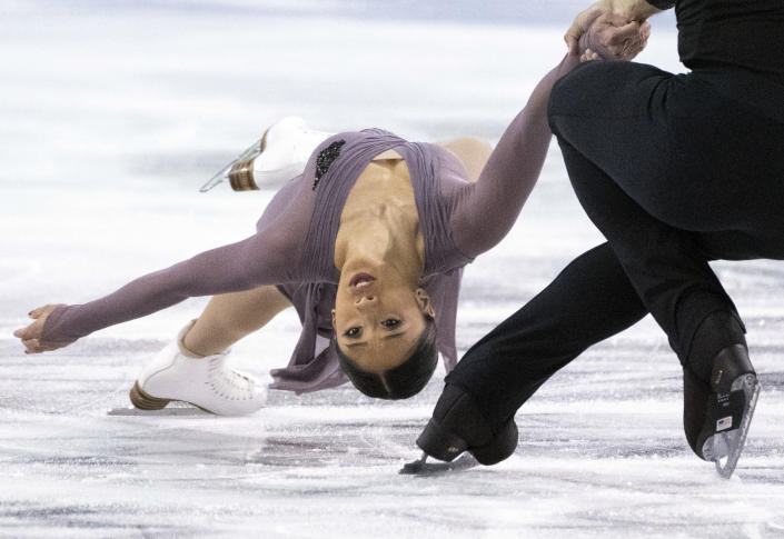 FILE - In this Oct. 25, 2019, file photo, Jessica Calalang and Brian Johnson, of the United States, perform their short program in the pairs competition at the Skate Canada figure skating event in Kelowna, British Columbia. Calalang, a U.S. pairs skater and potential member of the team for next February's Winter Games in Beijing, recently had a suspension from the sport overturned. Calalang had tested positive for a banned substance in January at the national championships, and it took eight months for her name to be cleared. (Paul Chiasson/The Canadian Press via AP, File)
