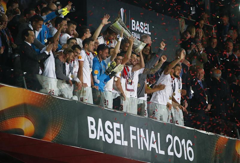 Sevilla celebrate with the trophy after winning the UEFA Europa League Final