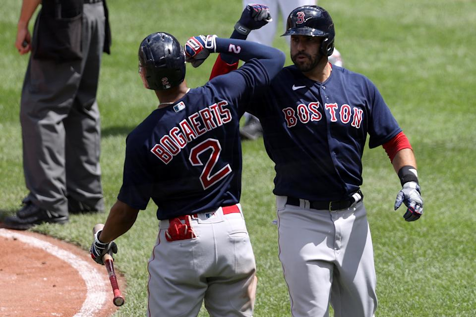 BALTIMORE, MARYLAND - APRIL 11: J.D. Martinez #28 of the Boston Red Sox celebrates with Xander Bogaerts #2 after hitting a solo home run against the Baltimore Orioles in the third inning at Oriole Park at Camden Yards on April 11, 2021 in Baltimore, Maryland. (Photo by Rob Carr/Getty Images)