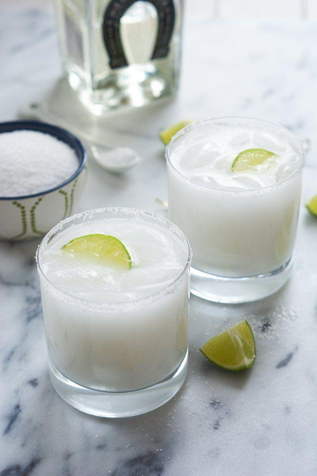 """<p>Coconut and lime are a tropical match made in heaven.</p><p>Get the recipe from <a href=""""http://withsaltandwit.com/skinny-coconut-margarita/"""" rel=""""nofollow noopener"""" target=""""_blank"""" data-ylk=""""slk:With Salt & Whit"""" class=""""link rapid-noclick-resp"""">With Salt & Whit</a>.</p>"""