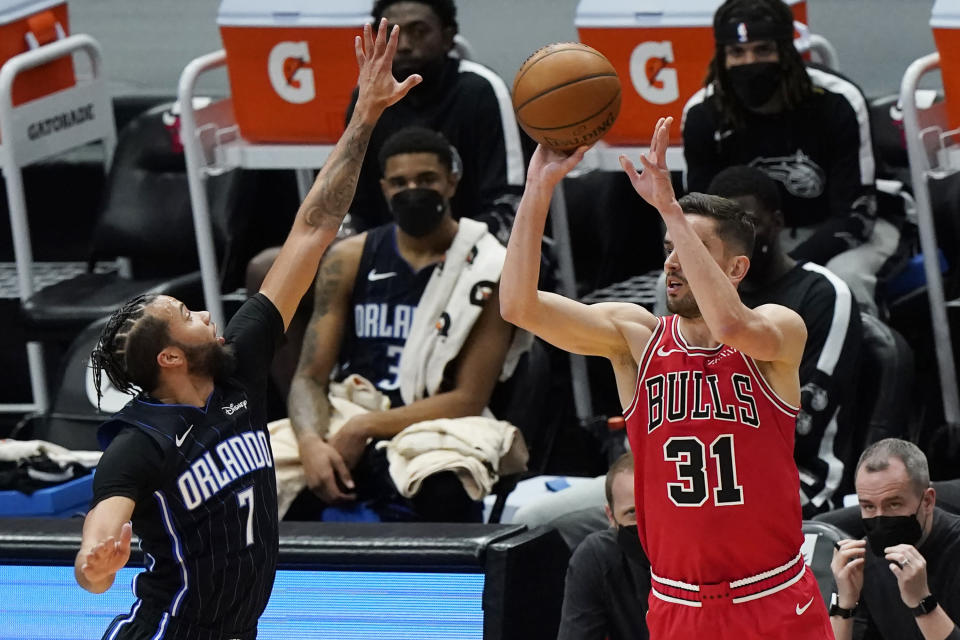 Chicago Bulls guard Tomas Satoransky, right, shoots against Orlando Magic guard Michael Carter-Williams during the first half of an NBA basketball game in Chicago, Wednesday, April 14, 2021. (AP Photo/Nam Y. Huh)