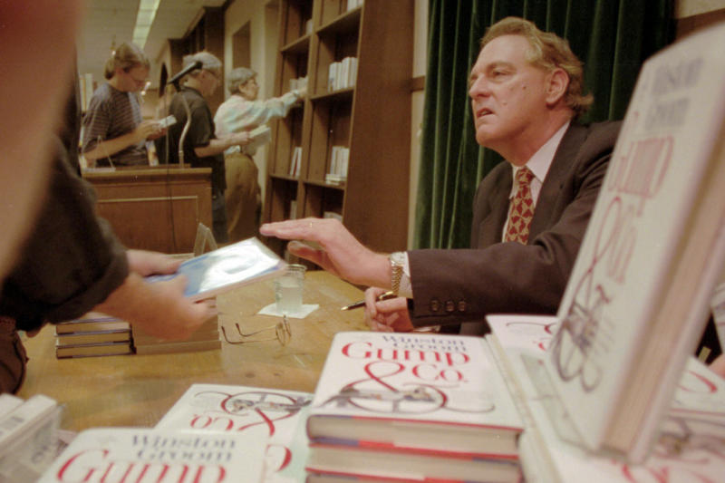 "FILE - In this Aug. 21, 1995, file photo, Winston Groom, author of ""Forrest Gump,"" the book on which the film was based, signs copies of ""Gump & Co.,"" the sequel to ""Forrest Gump"", at a New York City bookstore. Groom, the author of the novel ""Forrest Gump"" that was made into a six-Oscar winning 1994 movie that became a soaring pop culture hit, has died, an Alabama official close to the writer said Thursday, Sept. 17, 2020. He was 77. (AP Photo/Anders Krusberg, File)"