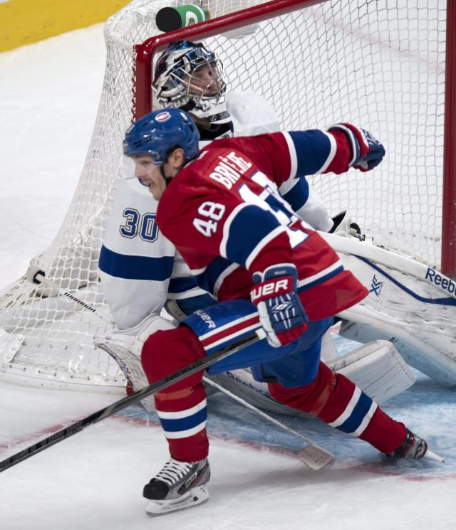 Montreal Canadiens' Daniel Briere celebrates his goal past Tampa Bay Lightning goalie Ben Bishop during the third period of an NHL hockey game Tuesday, Nov. 12, 2013, in Montreal. (AP Photo/The Canadian Press, Paul Chiasson)