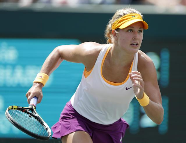 Eugenie Bouchard, of Canada, runs to the ball while playing against Jelena Jankovic, of Serbia, during the Family Circle Cup tennis tournament in Charleston, S.C., Friday, April 4, 2014. (AP Photo/Mic Smith)