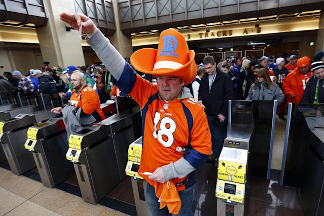Football fans enter the Secaucus Junction, Sunday, Feb. 2, 2014, in Secaucus, N.J. The Seattle Seahawks are scheduled to play the Denver Broncos in the NFL Super Bowl XLVIII football game on Sunday evening at MetLife Stadium in East Rutherford, N.J. (AP Photo/Matt Rourke)