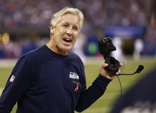 Seattle Seahawks head coach Pete Carroll questions a call during the first half of an NFL football game against the Indianapolis Colts in Indianapolis, Sunday, Oct. 6, 2013. (AP Photo/Brent R. Smith)