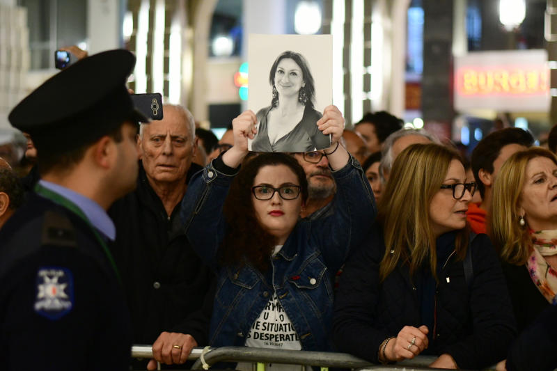 A protestors holds up a pictures of slain journalist Daphne Caruana Galizia during a demonstration outside Malta's prime minister's office in Valletta, Malta, Wednesday, Nov. 27, 2019. On Wednesday Maltese police arrested Prime Minister Joseph Muscat's former chief of staff Keith Schembri for questioning as a person of interest in the murder of journalist Daphne Caruana Galizia. (AP Photo/Str)